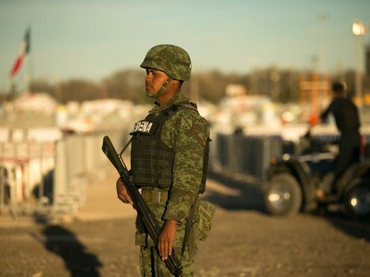 Mexican military stand guard at the fairgrounds in