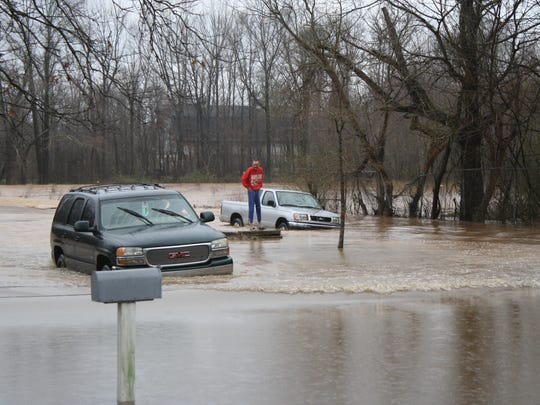 Billy Finnell drives his SUV through high water on