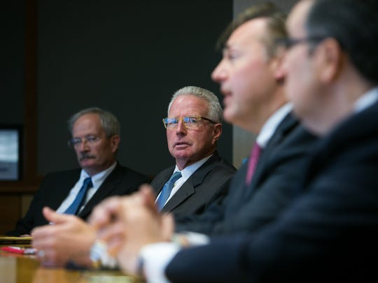 Delaware Board of Trade official Dennis Toner looks on as the principals of a proposed stock exchange in Wilmington speak with reporters, editors and editorial board staffers at The News Journal office.