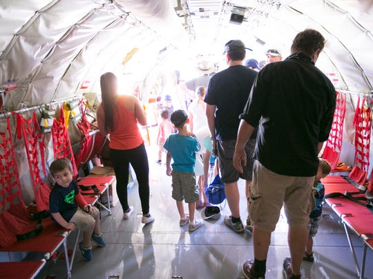 People tour the inside of a KC-135R Stratotanker military