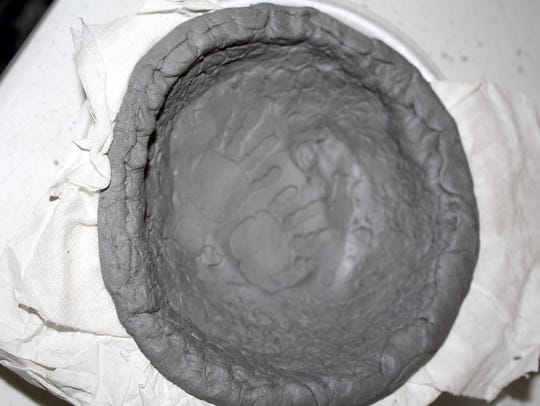 A bowl is made from clay. It will later be glazed,