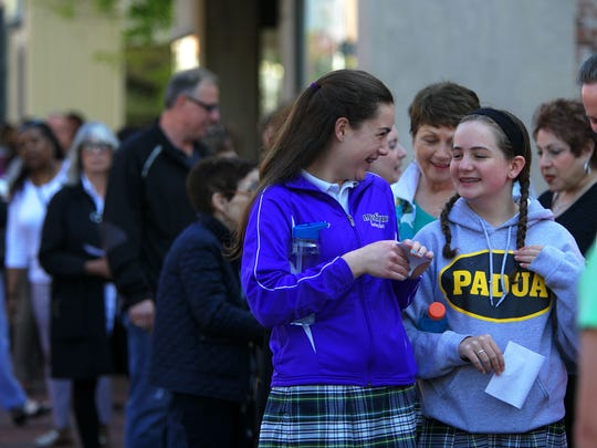 Maddy Frank, 14, (left) and Shannon Nagle, 14, wait in line outside of World Cafe Live at the Queen on Monday. Hillary Clinton spoke to about 700 people.