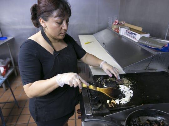 Chef and owner Elizabeth Hernandez sautŽes vegetables