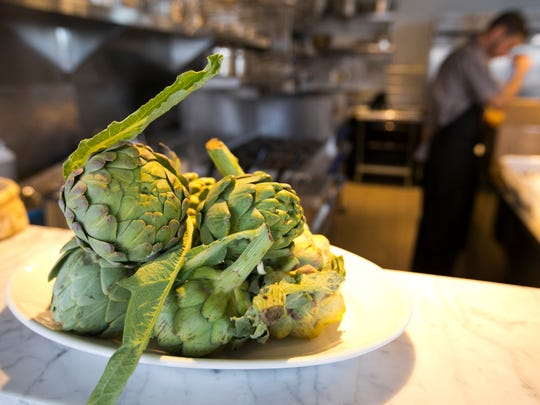 Artichoke sit on the countertops in the open-style