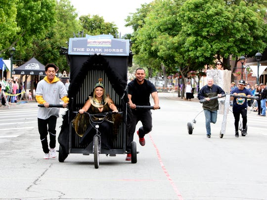 Entries in the inaugural Race of Thrones Crapper Derby raced down Main Street on Saturday morning.