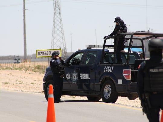 "Mexican law enforcement guard a checkpoint near a Juárez prison where drug lord Joaquin ""El Chapo"" Guzman was transferred early Saturday."