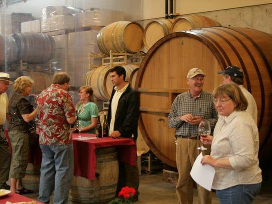 Guests sample wines at Illahe Vineyards during Memorial