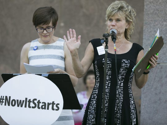 "Christine Marsh speaks to the crowd during a ""Now it Starts"" rally on May 19, 2016, in Phoenix, Arizona. The rally was to put pressure on leaders to focus on money for education."