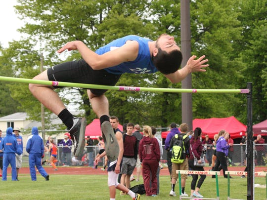 Clyde's Lucas Nicely competes in the high jump at the Division II district meet.