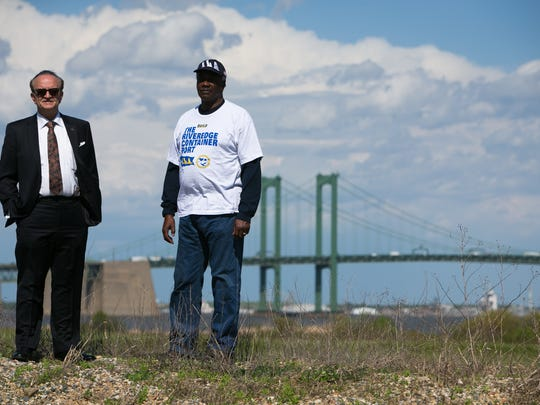 "New Castle County Executive Thomas P. Gordon (left) and Ronald ""Kimoko"" Harris, of International Longshoremen's Association Clerks and Checkers Local 1883, stand with the Delaware Memorial Bridge in the background. A task force was created by the General Assembly last year to provide the state with guidance on how to grow the state's maritime economy."