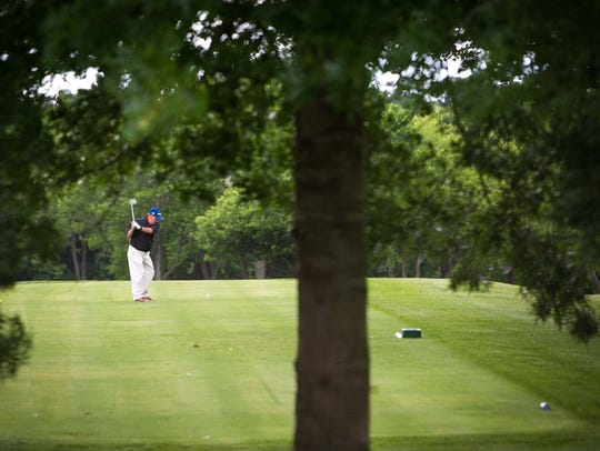 A golfer plays at the Cavaliers Golf Course in Christiana