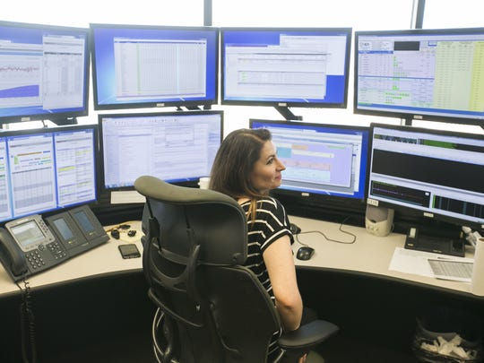 Emily Coats, real-time trader, looks over from her