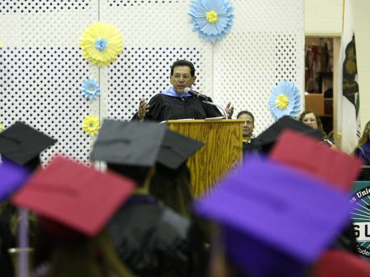 Keynote speaker Julian John Macias addresses the graduates during the Salinas Union High School District's Summer Commencement Ceremony.