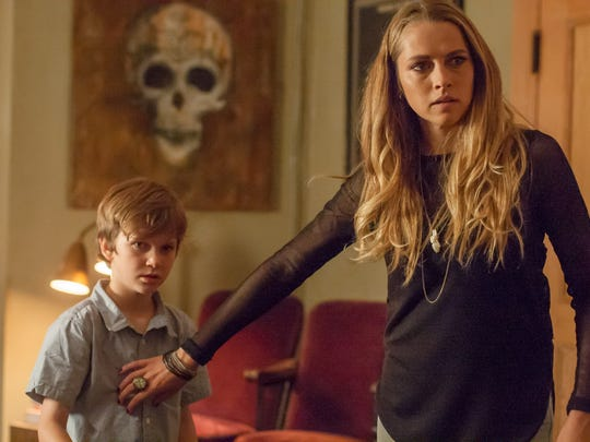 """In """"Lights Out,"""" Rebecca (Teresa Palmer) attempts to keep her brother (Gabriel Bateman) out of danger."""