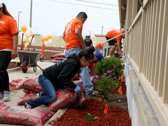 Home Depot employees donated their time to come help make improvements at the Veterans Transition Center in Marina on Thursday.