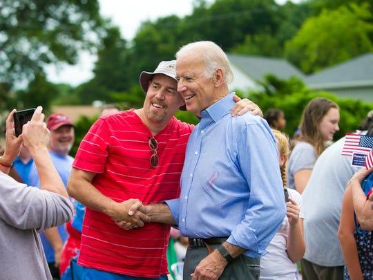 Vice President Joe Biden stops to take a photo with