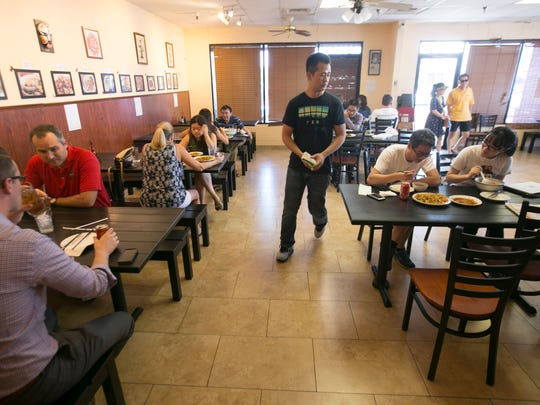 Staff serves patrons at House of Egg Roll in Chandler on July 22, 2016.