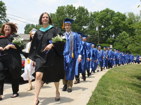 photos by Chris Mayhew/The Community Recorder Teachers Kym Grillot, left, and Jennifer Nash lead class valedictorian Logan Joseph Groneck and other graduates in a line across campus into commencement. HIGHLANDS HIGH SCHOOL GRADUATION SUNDAY, JUNE 7 2015: Teachers Kym Grillot, left, and Jennifer Nash, lead class valedictorian Logan Joseph Groneck and other graduates in a line across campus into commencement.