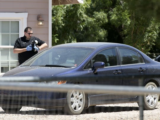 Investigators work the scene of a home at the 17700 block of East Prescott Place of unincorporated Maricopa County near south  Gilbert where multiple bodies were found on Tuesday, July 26, 2016.
