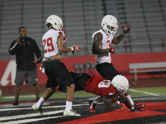 Defensive back Malik Boynton tries to back off as a Governors' running back falls to the ground during practice on Saturday, Aug. 6.