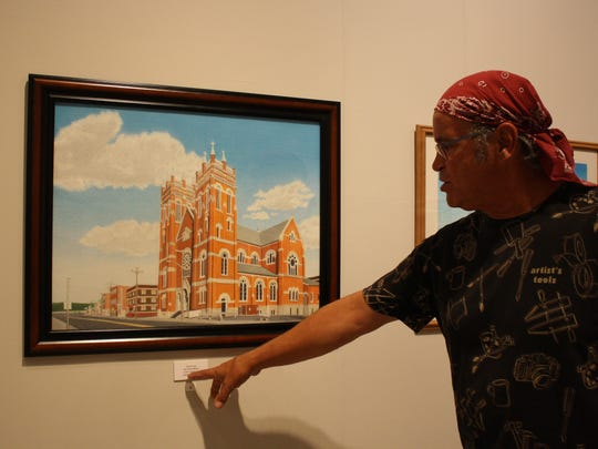 Victor Lay explains his process behind his colored-pencil drawing of St. Mary's Church on Wednesday.