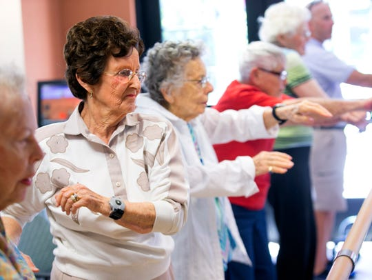 Magda Willinger, a Holocaust survivor, exercises in