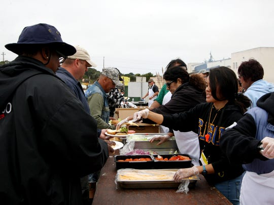Volunteers serve lunch to veterans during the Monterey County Homeless Stand Down for Homeless Veterans on Saturday.