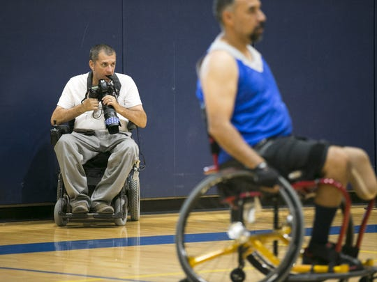 Loren Worthington photographs an Ability 360 wheelchair basketball practice at the Ability360 Sports & Fitness Center in Phoenix on Sept. 1, 2016. Worthington, who is quadriplegic, is in Rio photographing the Paralympic Games.