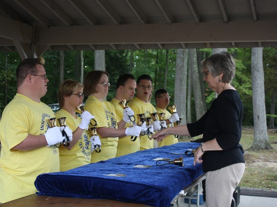 """The Pathfinder Village Hand Bell Choir, of Edmeston, N.Y., performs """"Let there be Peace on Earth."""""""
