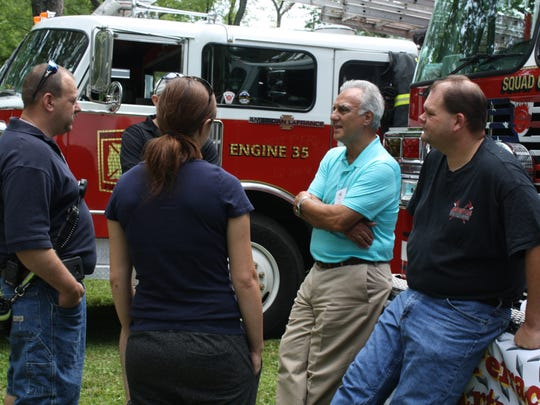 Town of Dickinson supervisor Michael Marinaccio (in green), speaks to members of the  Prospect Terrace Fire Department during the Town of Dickinson 125 Anniversary Party.