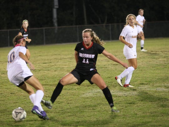 Rossview's Madigan Burman (11) tips the ball away from