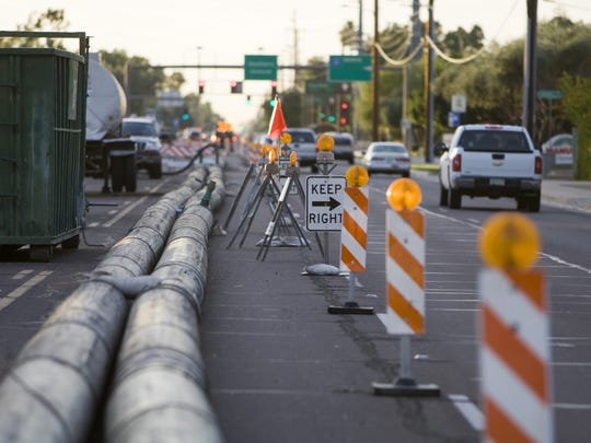 Construction workers put up  sewer lines to be installed on Southern Avenue near Price Road in Tempe.