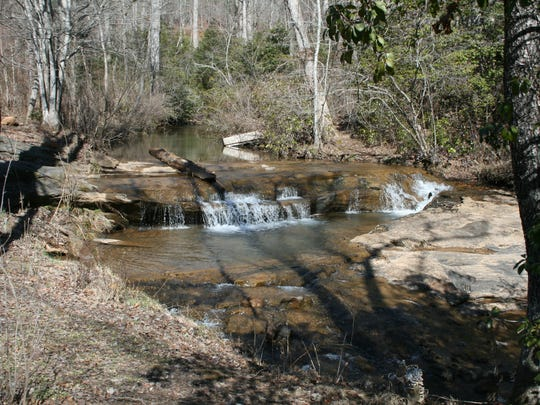 These small falls and stream feed into the Hagood Mill's