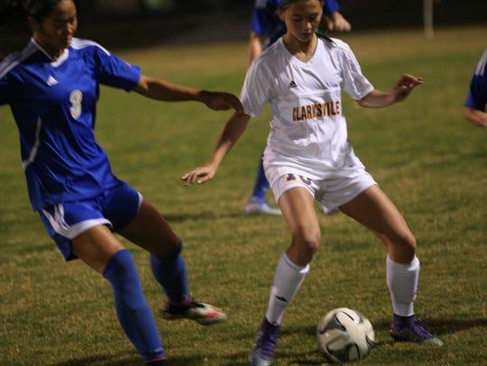 Clarksville's Kristen Gasaway tries to keep the ball