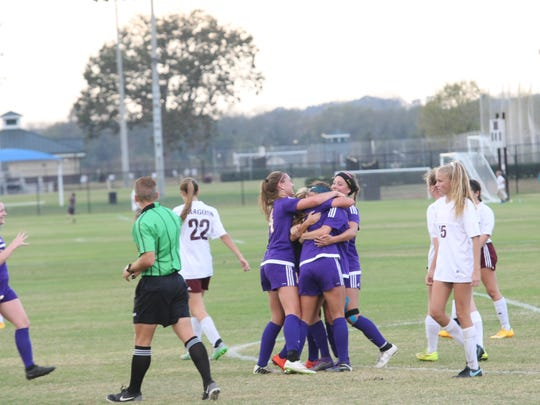 Clarksville High players celebrate after Gybson Roth's