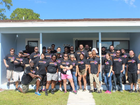 The Kohl's volunteer group stands in front of the the Boys & Girls Clubs of St. Lucie County's Garden Terrace Teen Center.