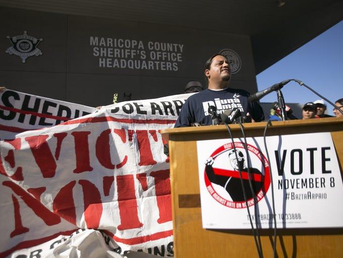 Carlos Garcia, director of Puente, speaks in front