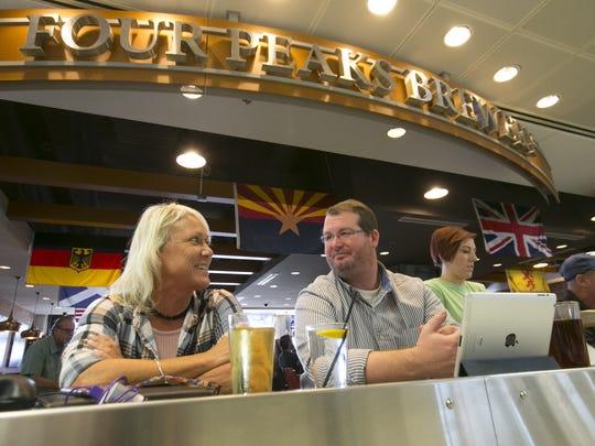 Priscilla Tremain of Orlando, Fla., and John Ganley of  Spokane, Wash., at Four Peaks Brewery at Terminal 4 in Phoenix Sky Harbor International Airport on Thursday, November 10, 2016.