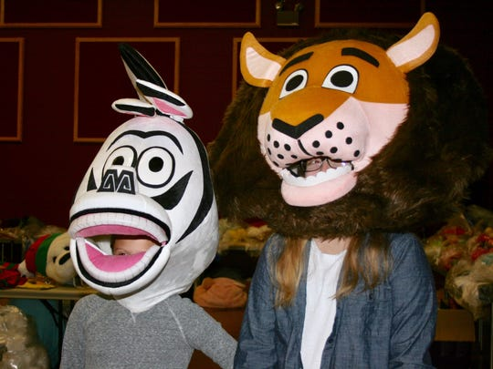 """Characters from the movie """"Madagascar"""" are among the new costumes in this year's Downtown Elmira Holiday Parade."""