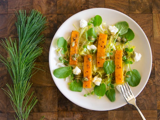 Roasted butternut squash and goat cheese salad with pumpkin seed vinaigrette, a great holiday salad, is seen at the J&G Steakhouse at the Phoenician in Scottsdale on Dec. 1, 2016.