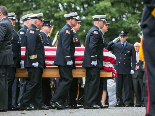 Family and friends, the Wilmington Fire Department and local first responders attend the viewing and funeral Mass of Lt. Christopher Leach at St. Elizabeth Church in Wilmington.