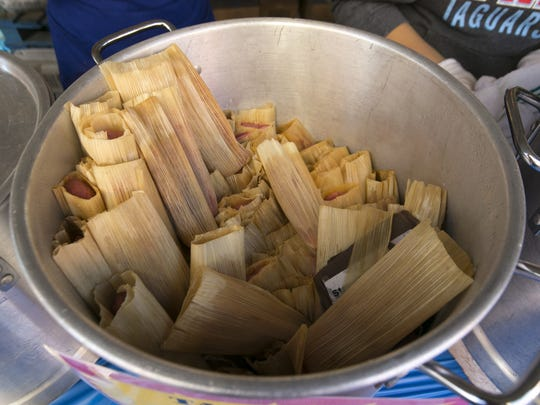 Tamales are kept warm in a pot during the Food City