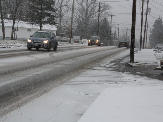 Cars drive on Riverside Drive in Johnson City during a snowfall on Dec.11.