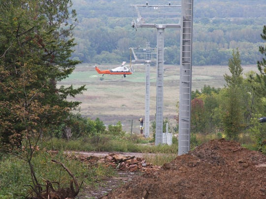 A helicopter helps install the towers on the new Cindy Pop chairlift at Cascade Mountain in Portage.