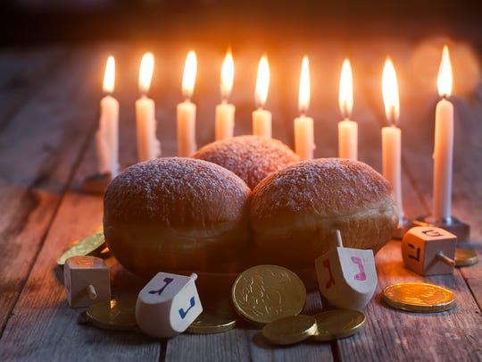 Jewish holiday hanukkah symbols - menorah, doughnuts, chocolate coins and wooden dreidels.