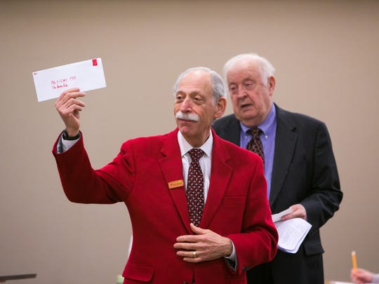 """Playing the defense attorney, Richard Herrmann, acts out a court scene from the movie """"A Miracle on 34th Street"""" at the Leonard L. Williams Justice Center Friday. The event has become a tradition for the judges and attorneys every year since 2004."""