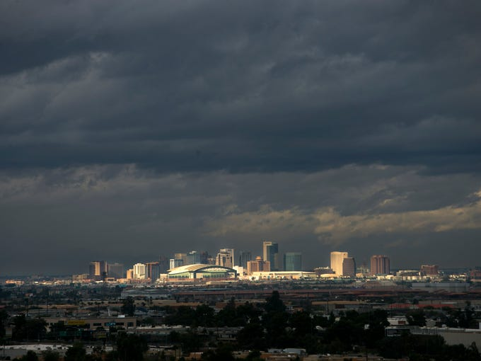 Ominous clouds are seen over downtown Phoenix on Saturday,