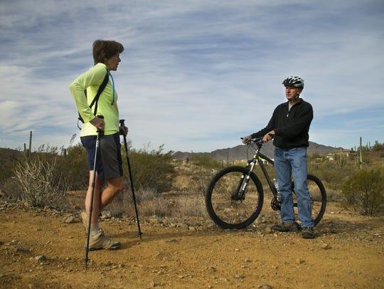 Maricopa County Supervisor Andy Kunasek talks to hiker