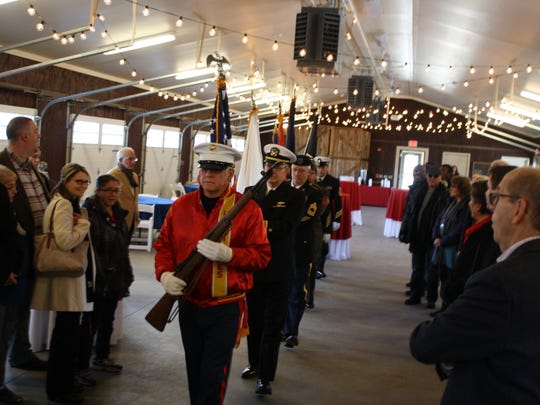 The Broome County Veterans Memorial Association Honor Guard advances to post the colors during the 2017 inauguration ceremony on Sunday.