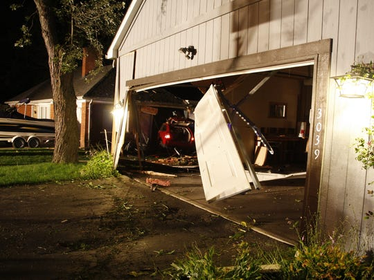 Waterford Township Police Department said the driver of this SUV was drunk when he crashed into a garage and a second occupied home on Oct. 9.